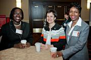 Katjana Ballantyne of GirlsLEAP (center) is flanked by John Hancock's Rebecca Amissah and Linda Watters during the social hour at the Boston Business Journal's Advancing Women breakfast held at the Sheraton Boston.