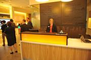 Visitors to Umpqua's San Francisco flagship are greeted at the concierge desk. The bank's mobile concierges can move throughout the branch, offering assistance.