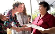 Secretary of the Interior Sally Jewell, left, congratulates Rita Mora on becoming a U.S. citizen at a naturalization ceremony for 21 people becoming U.S. citizens Monday at the Refugee Women's Alliance in Seattle.  The event was held on Women's Equality Day, which is the anniversary of passage of the 19th Amendment to the Constitution, granting women the right to vote.