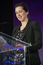 At the Boston Business Journal's Advancing Women breakfast, Christine Gallagher, director, advisory practice and co-chair network of women at KPMG, a presenting partner of the event, introduced The Center for Women & Enterprise's Susan Rittscher a recipient of a Lifetime Achievement Award.