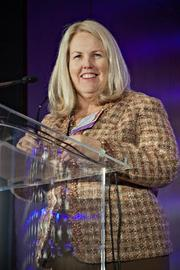 Susan Rittscher, president and CEO of The Center for Women & Enterprise, accepted a Lifetime Achievement Award at the Boston Business Journal's Advancing Women breakfast, saying she accepted it on behalf of the organization as well.