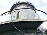The glass enclosure that houses the light at the top of Graves Island lighthouse.