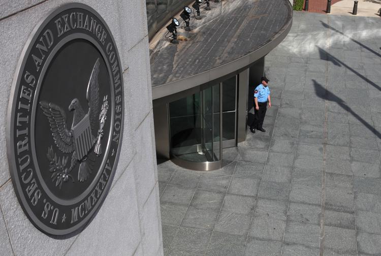 A security officer stands outside the U.S. Securities and Exchange Commission headquarters in Washington, D.C.