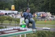 James Thomasson slides down the zip line at The Station at Grants Mill.