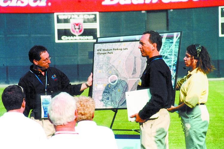 Back in 2002, Dan Knise, second from right, touted RFK Stadium as a venue for the 2012 Olympic Games. He's pictured here with D.C. sports commission official Bobby Goldwater, left.
