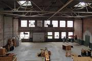 The 10,000-square-foot space exposed brick and metal rafters and tall ceilings and could play host to a number of uses, including retail or loft-style office.