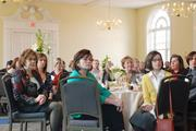 Attendees at Queens University of Charlotte's annual BusinessWoman of the Year luncheon listen as 2013 honoree Laura Schulte, eastern bank president for Wells Fargo & Co., gives her remarks.