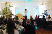 Attendees at Queens University of Charlotte's BusinessWoman of the Year luncheon listen as honoree Laura Schulte, eastern bank president for Wells Fargo & Co., recounts the events following the San Francisco bank's merger with hometown giant Wachovia Corp.