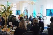 Pamela Davies, president of Queens University of Charlotte, welcomes attendees to the 2013 BusinessWoman of the Year luncheon.