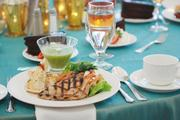 Attendees at Queens University of Charlotte's BusinessWoman of the Year luncheon were treated to grilled chicken, a capris salad and chocolate cake.