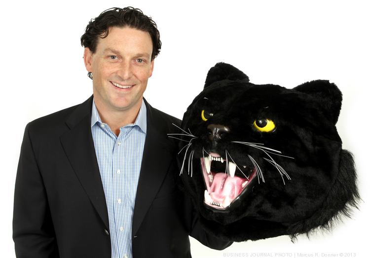 2013 PSBJ 40 under 40 honoree John Gabbert, CEO & Founder, PitchBook Data, Inc. Gabbert hold his company's mascot the PitchBook panther.