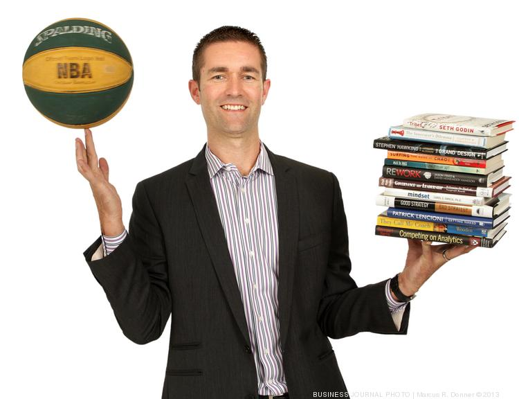 2013 PSBJ 40 under 40 honoree Kevin Mackey, Practice Leader - Business Intelligence and Analytics, Point B Inc. For Mackey both the spinning basketball and the books on a wide variety of subjects represents being balanced and well rounded in life.
