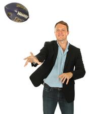 2013 PSBJ 40 under 40 honoree Mike Fridgen, President & CEO, of Decide, Inc.  Fridgen tosses the UW football that gets tossed around at staff meetings at his office to remind them of the spirit of competing.