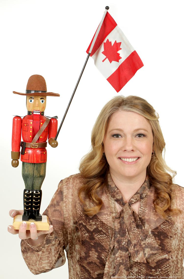 2013 PSBJ 40 under 40 honoree Pamela Quadros, Vice President General Manager, titan360.com. Quadros, who is Canadian, holds a Canadian Mountie nutcracker her Mom gave her so she doesn't forget where she came from.