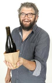 2013 PSBJ 40 under 40 honoree Paul Zitarelli, Owner, of Full Pull Wines. Zitarelli sometimes does blind tastings for customers usually just putting the bottle in a paper bag.