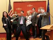 From left: Wisconsin tourism secretary Stephanie Klett; Katie Sawyer, who appeared in the commercial; Gov. Scott Walker; Caitlin Machol, who also appears in the commercial; Robert Hays; David Zucker; and deputy tourism secretary Dave Fantle.