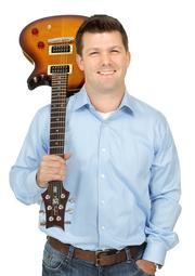 2013 PSBJ 40 under 40 honoree Ryan Neal, Managing Partner, at Pendulum Investments, LLC.  Neal enjoys playing his favorite Paul Reed Smith guitar.