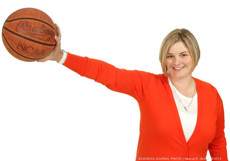 2013 PSBJ 40 under 40 honoree Tonya Swick, Executive Director, Samena Club.  Swick played basketball in her college days and holds a basketball she used as a collegiate athelete.