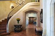 The house has a custom-built spiral staircase and hand-pieced walnut floors.