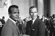 Singer, songwriter, actor and activist Harry Belafonte stands with actor Charlton Heston on Aug. 28, 1963. Belafonte recruited celebrities to attend the historic event.