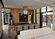 The living and kitchen areas are bright with natural light. All cabinetry and built-in furniture, designed and built by the students, is of laminated bamboo, an eco-friendly product.