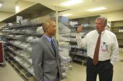 Calvin Hung, administrator for Carolinas HealthCare Rehabilitation's Pineville campus, and Dan Dunmyer, CEO of Carolinas Specialty Hospital, tour the materials management space for both facilities.