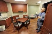 Calvin Hung, administrator of Carolinas HealthCare System Rehabilitation's Pineville campus, shows off the transitional living apartment where patients will test and practice activities of daily living such as cooking.