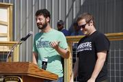 Kellan and Davin and Bartosch welcome the crowd to their new brewery.