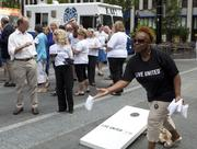 Venita Lynn tosses a bag during a game of cornhole on Fountain Square.