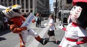 Who Dey and Rosie Red dance on Fountain Square at the United Way campaign goal announcement celebration.
