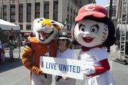 Toni Lehmkuhl of the United Way marketing department poses for a picture with Who Dey and Rosie Red.