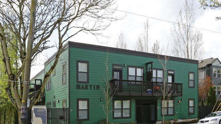 The Martin, a 14-unit apartment in Northeast Portland, is part of a three-building portfolio that just sold for $9.05 million.