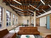 The offices of Peddle LLC were created in a decaying 19th century building on West Sixth Street utilizing reclaimed wood and more contemporary touches.