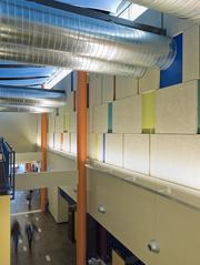 The Travis County North Central Health Center features a two-story atrium, lively patterns and vivid ribbons of color.