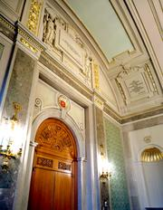 The restoration of the president's reception room included preserving exquisite gilded plaster work.