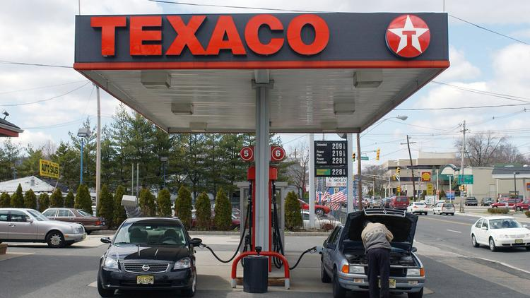 27093ef8c A gas station attendant checks a customer s oil at a Texaco station in  Millburn