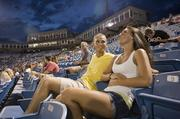 Nashville residents Brock Ballou, left, and Kendall Witzky attend a Sounds game at the 35-year-old Greer Stadium (pictured on cover), which has struggled to fill seats.