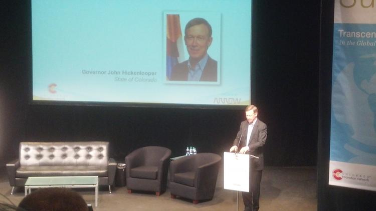 Gov. John Hickenlooper welcomes attendees to the 2013 Colorado Innovation Summit Wednesday, Aug. 28, at the Denver Performing Arts Complex.