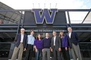 The Wright Runstad & Co. team that developed the new Husky Stadium project gathers at the northwest entrance. From left: Greg Johnson, president; Brian Domini, construction manager; Tara Howard, project manager; Chris Broadgate, project manager; Walt Ingram, executive vice president and CFO; Cindy Edens, senior vice president and director of development; and Jon Runstad, co-founder, chairman and chief executive officer.