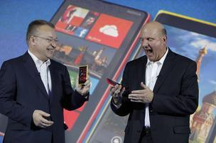 Nokia CEO Stephen Elop, left, is returning to Microsoft in a $7.2 billion deal in which the software giant is buying his company's phone business. He has been rumored as a possible successor to outgoing CEO Steve Ballmer, who announced a number of executive changes after the news broke late Monday.