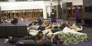 Players relax in the Barnard Family Husky Locker Room, which features new lockers, the latest multimedia technology and a lounge area.