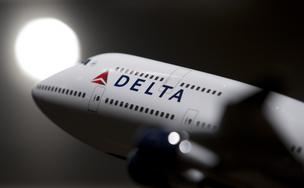 Delta Air Lines says it is transferring about 5 percent of its Twin Cities-based pilots to other airports. Pictured is a model of a Delta aircraft.