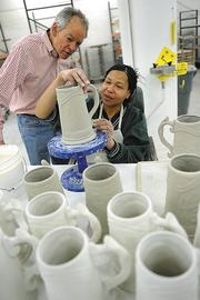 Rookwood owner Martin Wade watches Diane Jackson work on the latest Rookwood Pottery stein, this one featuring the new Hollywood Casino. ROOKWOOD POTTERY Founded: 1880 Ceased production: 1967 Re-launched: 2006 Current ownership: 2011 Owners: Martin and Marilyn Wade Location: Over-the-Rhine