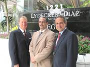 Reginald J. Clyne, center, joined Richard Lydecker and Manny Diaz at Lydecker Diaz, which acquired his former firm, Clyne & Associates.