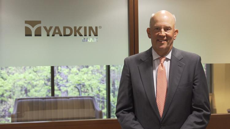 Scott Custer, who led RBC Bank's move from Rocky Mount to Raleigh, announced that his current bank, Yadkin, is selling to FNB.