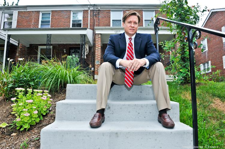 Six-year Congress Heights resident Brian Townes, a Realtor, has a contract on a condo and is renting out three other homes, including one to a young, white couple.