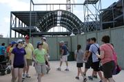 Universal Studios guests make their way around the construction walls at the Harry Potter expansion.