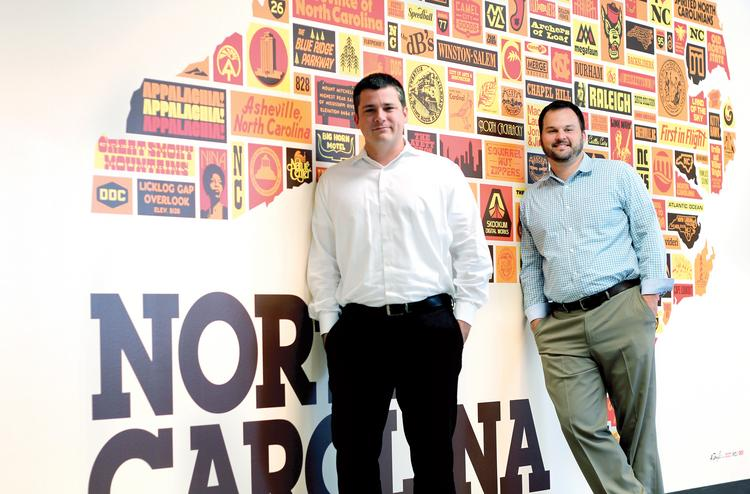 Skookum owners Bryan Delaney (left) and James Hartsell say their firm has grown, in large part, because they don't tolerate mediocrity.
