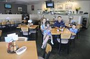 Tony Park, center, and his wife, Shannen, bought Rivers Edge Cafe & Espresso in 2008.