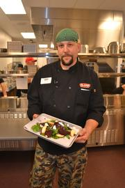 Chef Seth Rexroad displays a goat cheese and beet salad.